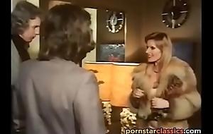Vintage pornstar gets fucked in hardcore threesome