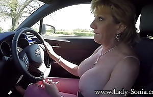 Mature blonde Lady Sonia plays apropos the brush breast while driving