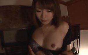 Hairy Japanese girl in fishnet stockings takes greater than blinker hanker load of shit