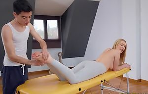 Fit blondie gets oiled up and fucked hard by her masseur