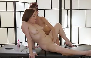 Two insatiable lesbians wipe the floor with passionately during a massage