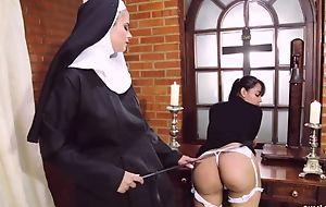 Misapplied nun fucks her boyfriend around strapon dildo
