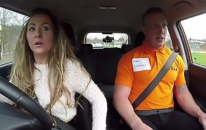 Long-haired MILF blows the brush car driving instructor